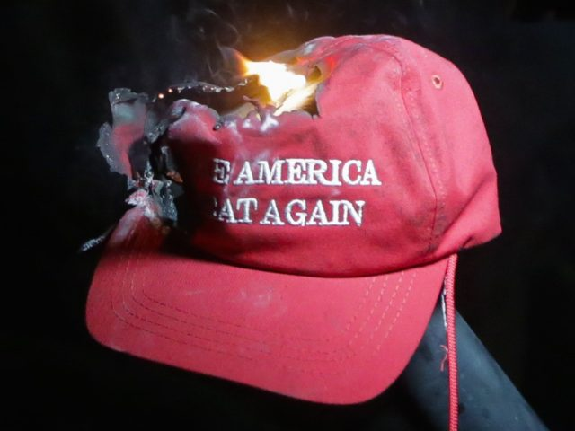 MAGA-Make-America-Great-Again-hat-burning-at-Berkeley-Getty-e1488567121474